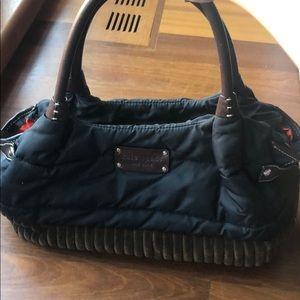 Kate spade medium black handbag brown trim,handles